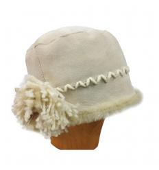Chapeau beige en cuir de mérino et laine avec fleur